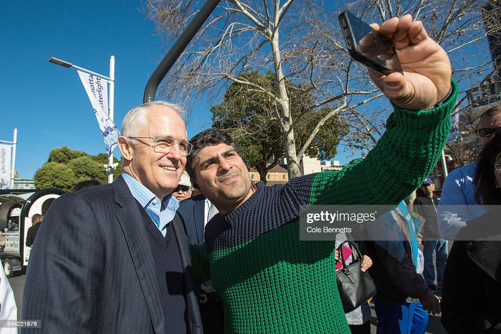 Prime Minister Malcom Turnbull gets a selfie with a member of the public who was lining up at the Parramatta Town Hall to vote on July 2, 2016 in Parramatta, Australia. Voters head to the polls today to elect the 45th parliament of Australia.