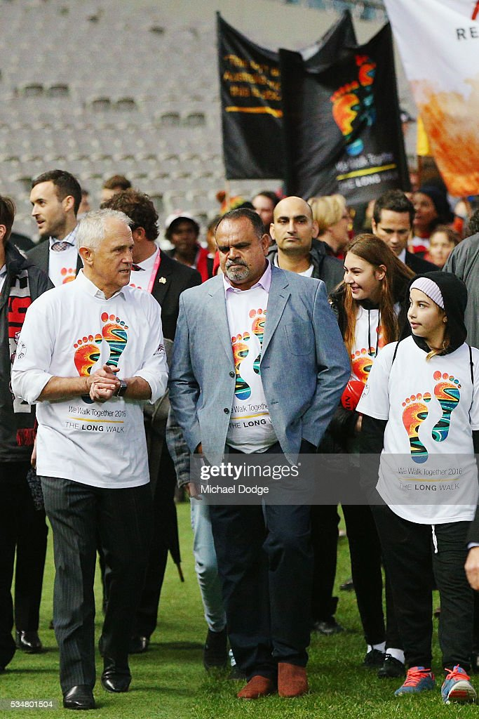 Prime Minister Malcom Turnbull joins former Bombers legend <a gi-track='captionPersonalityLinkClicked' href=/galleries/search?phrase=Michael+Long+-+Jugador+de+f%C3%BAtbol+australiano&family=editorial&specificpeople=178977 ng-click='$event.stopPropagation()'>Michael Long</a> for The Long Walk before the round 10 AFL match between the Essendon Bombers and the Richmond Tigers at Melbourne Cricket Ground on May 28, 2016 in Melbourne, Australia. The Long Walk raises awareness for Indigenous affaits.