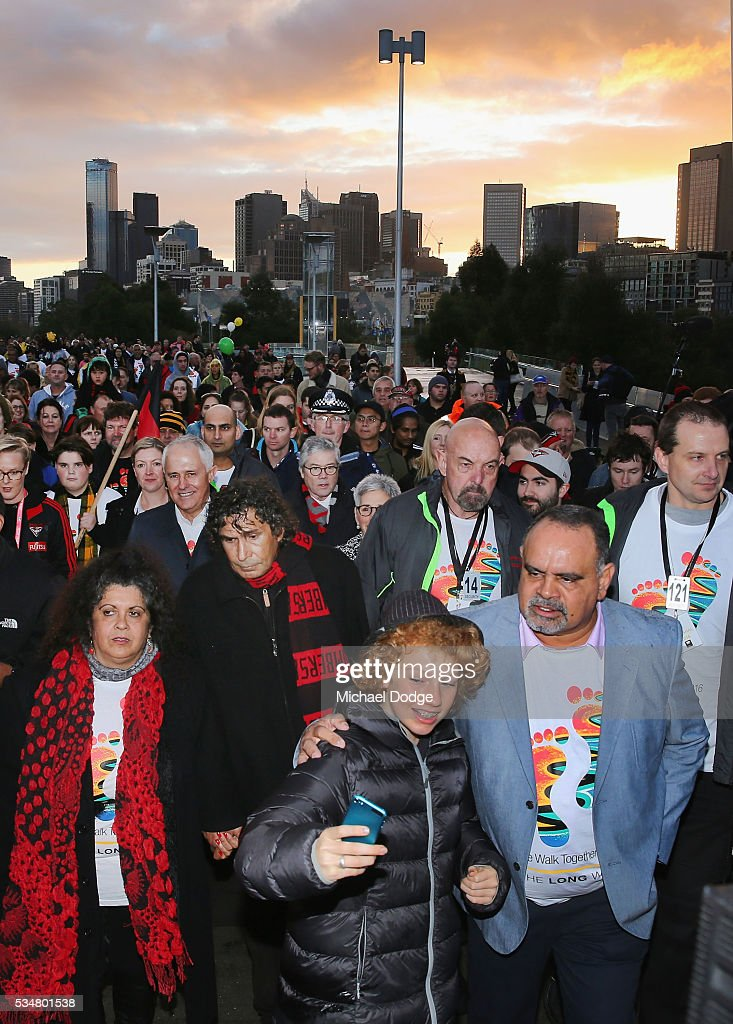 Prime Minister Malcom Turnbull joins former Bombers legend <a gi-track='captionPersonalityLinkClicked' href=/galleries/search?phrase=Michael+Long+-+Giocatore+di+football+australiano&family=editorial&specificpeople=178977 ng-click='$event.stopPropagation()'>Michael Long</a> (R) for The Long Walk before the round 10 AFL match between the Essendon Bombers and the Richmond Tigers at Melbourne Cricket Ground on May 28, 2016 in Melbourne, Australia. The Long Walk raises awareness for Indigenous Rights affairs.