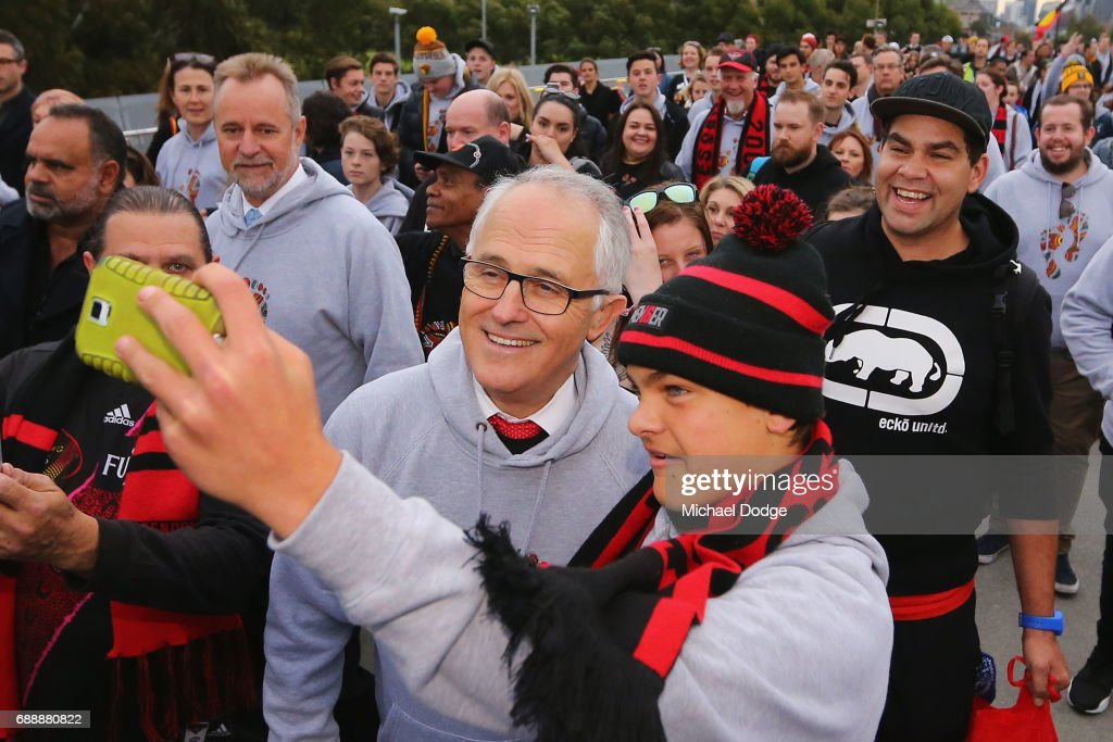 Prime Minister Malcom Turnbull poses with a Bombers fans during The Long Walk before the round 10 AFL match between the Richmond Tigers and the Essendon Bombers at Melbourne Cricket Ground on May 27, 2017 in Melbourne, Australia.