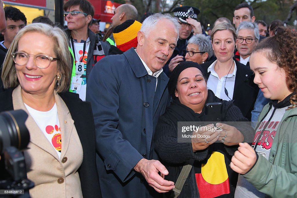 Prime Minister Malcom Turnbull poses with Bombers fans during The Long Walk before the round 10 AFL match between the Essendon Bombers and the Richmond Tigers at Melbourne Cricket Ground on May 28, 2016 in Melbourne, Australia. The Long Walk raises awareness for Indigenous Rights affairs.