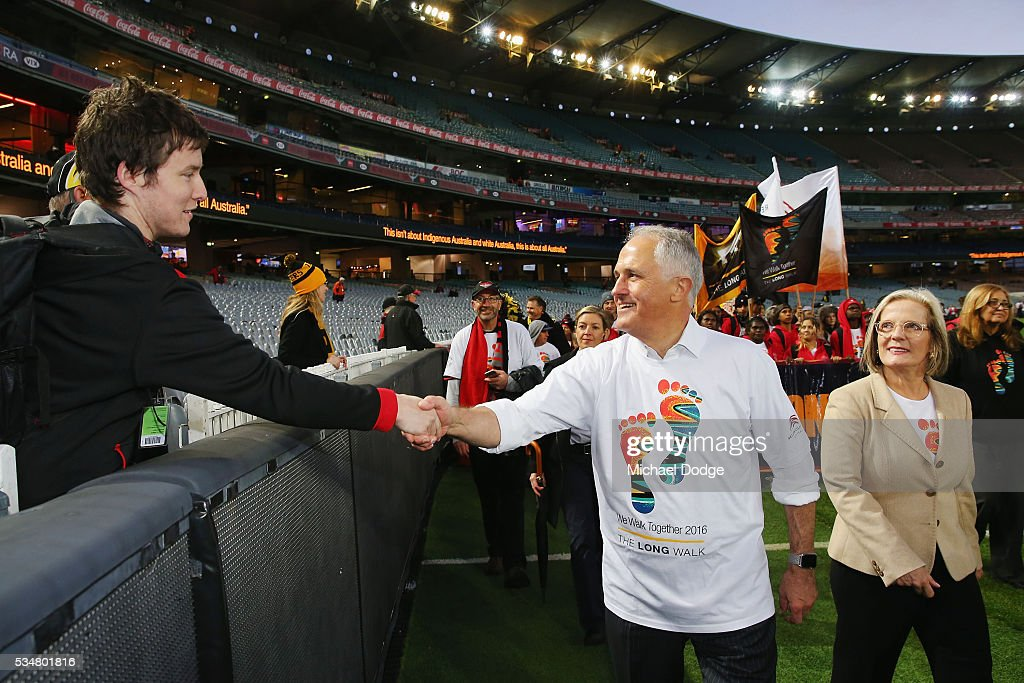Prime Minister Malcom Turnbull shakes a Bombers fans hand during The Long Walk before the round 10 AFL match between the Essendon Bombers and the Richmond Tigers at Melbourne Cricket Ground on May 28, 2016 in Melbourne, Australia. The Long Walk raises awareness for Indigenous Rights affairs.