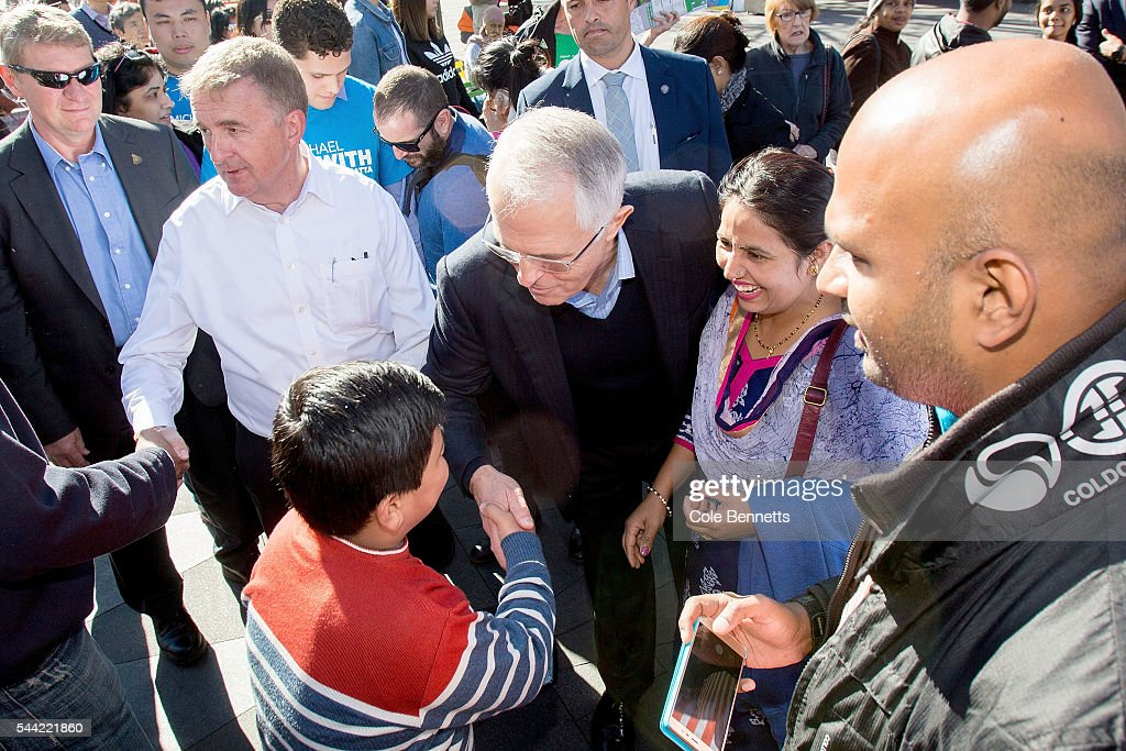 Prime Minister Malcom Turnbull with libral candidate, Michael Beckwith meets the public as they prepare to vote at the Parramatta Town Hall on July 2, 2016 in Parramatta, Australia. Voters head to the polls today to elect the 45th parliament of Australia.