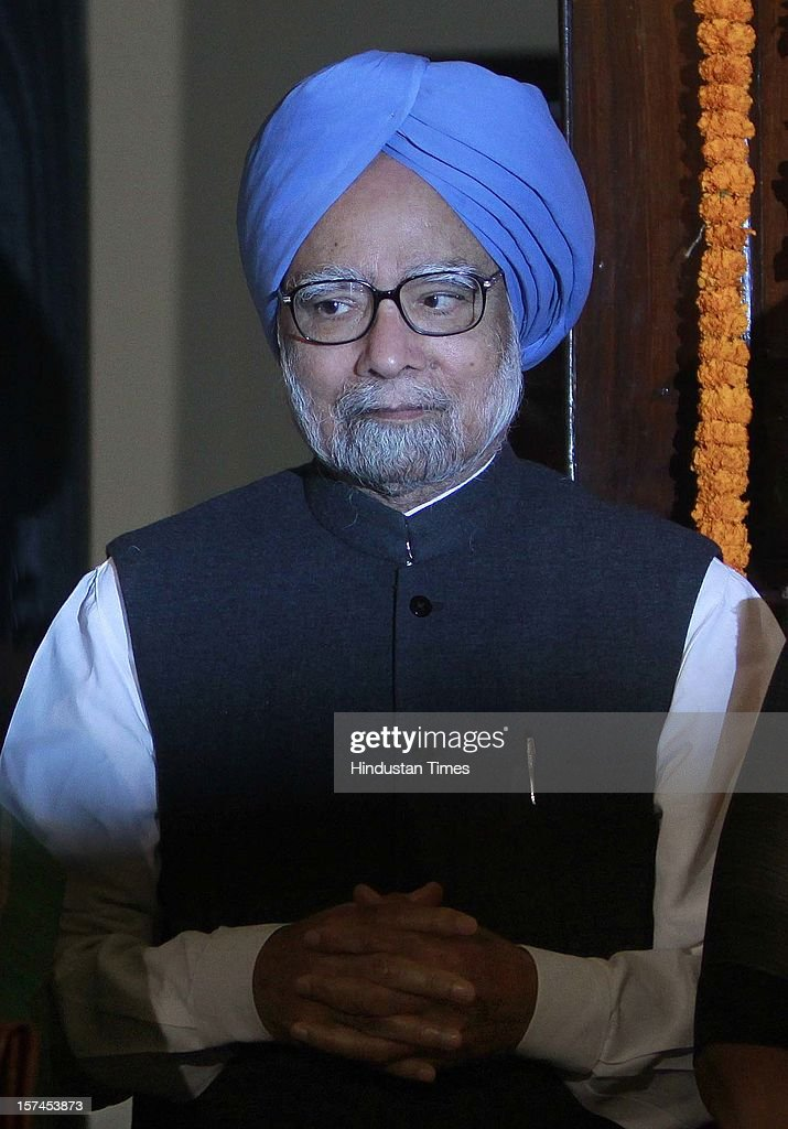 Prime Minister Manmohan Singh, after paying floral tributes at the portrait of the First President of India, Late Dr. Rajendra Prasad on the occasion of his 128th birth anniversary, at Parliament House on December 3, 2012 in New Delhi, India.