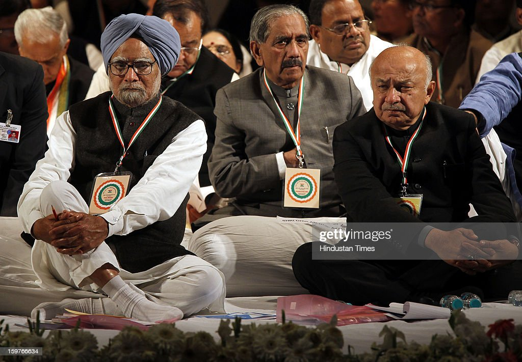 Prime Minister Manmohan Singh and Congress leader Sushil Kumar Shinde during the AICC meeting after the two days 'Chintan Shivir' at Birla Auditorium, Jaipur on January 20, 2013 in Rajasthan, India.