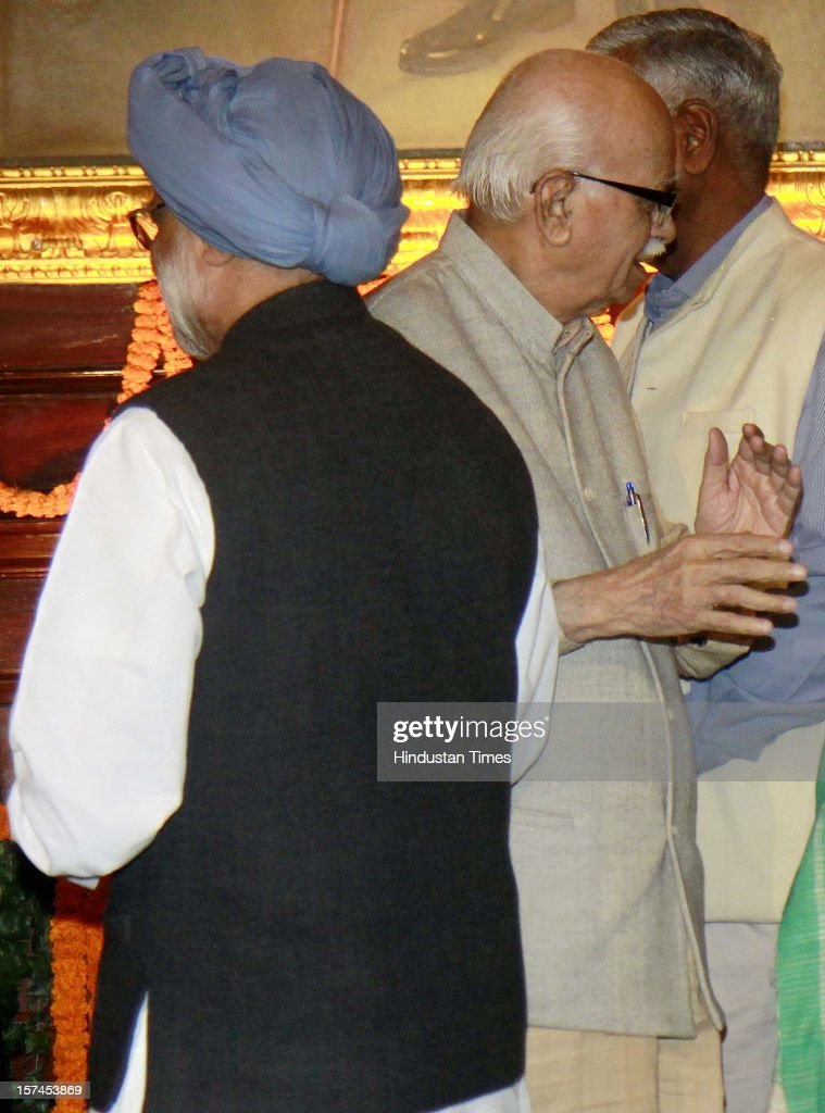Prime Minister Manmohan Singh and Sr. BJP Leader Lal Krishan Advani after paying floral tributes at the portrait of the First President of India, Late Dr. Rajendra Prasad on the occasion of his 128th birth anniversary, at Parliament House on December 3, 2012 in New Delhi, India.