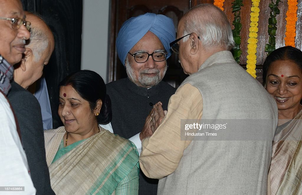 Prime Minister Manmohan Singh and Sushma Swaraj leader of opposition Lok Sabha and BJP Leader Lal Krishan Advani after paying floral tributes at the portrait of the First President of India, Late Dr. Rajendra Prasad on the occasion of his 128th birth anniversary, at Parliament House on December 3, 2012 in New Delhi, India.
