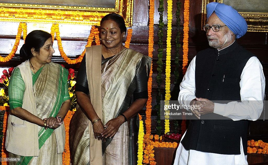 Prime Minister Manmohan Singh (C) and Sushma Swaraj leader of opposition Lok Sabha ( L ) lok sabha speaker Meira Kumar ( R) after paying floral tributes at the portrait of the First President of India, Late Dr. Rajendra Prasad on the occasion of his 128th birth anniversary, at Parliament House on December 3, 2012 in New Delhi, India.