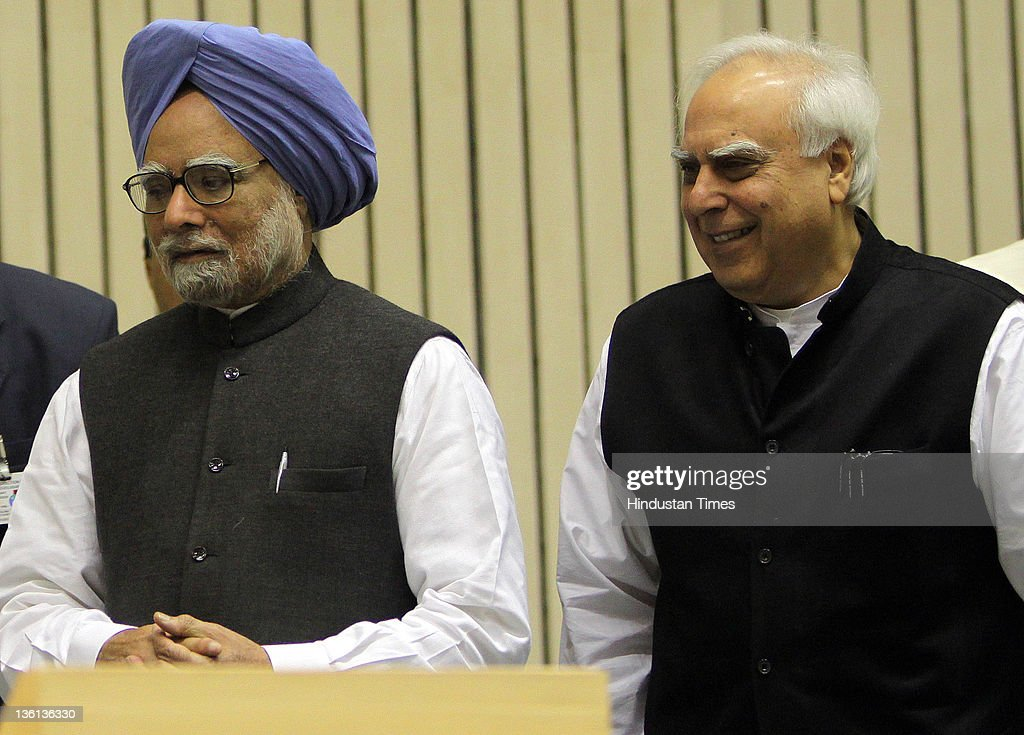 Prime Minister Manmohan Singh and Union Human Resource Development Minister Kapil Sibal attend a function to commemorate the 150th Birth Anniversary of Mahamana Madan Mohan Malaviya at Vigyan Bhawan on December 27, 2011 in New Delhi, India. A National Implementation Committee was formed under the chairmanship of Dr. Karan Singh to oversee the implementation of the various events aimed at promoting the ideals of Madan Mohan Malviya. Pandit Madan Mohan Malviya (1861-1946) was a prominent nationalist leader and served 4 times as the president of Indian National Congress. He also founded the Banaras Hindu University with Anne Besant.