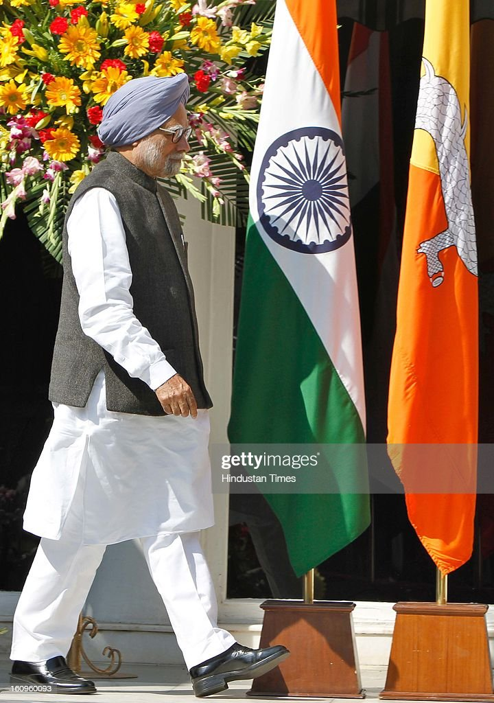 Prime Minister Manmohan Singh arrive to meet with his Bhutanese counterpart Lyonchhen Jigmi Y Thinley at his residence on February 8, 2013 in New Delhi, India.