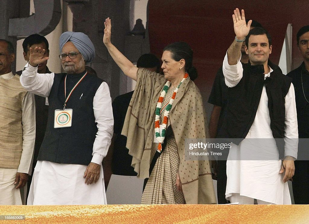 Prime Minister <a gi-track='captionPersonalityLinkClicked' href=/galleries/search?phrase=Manmohan+Singh&family=editorial&specificpeople=227120 ng-click='$event.stopPropagation()'>Manmohan Singh</a>, Congress President <a gi-track='captionPersonalityLinkClicked' href=/galleries/search?phrase=Sonia+Gandhi&family=editorial&specificpeople=2287581 ng-click='$event.stopPropagation()'>Sonia Gandhi</a> and General Secretary <a gi-track='captionPersonalityLinkClicked' href=/galleries/search?phrase=Rahul+Gandhi&family=editorial&specificpeople=171802 ng-click='$event.stopPropagation()'>Rahul Gandhi</a> greet the crowd at the party's Maharally at Ramlila Maidan on November 04, 2012 in New Delhi, India. The rally is expected to set the agenda for the party's one-day brainstorming session at Surajkund on November 9 in which it plans to discuss the current political and economic situation.