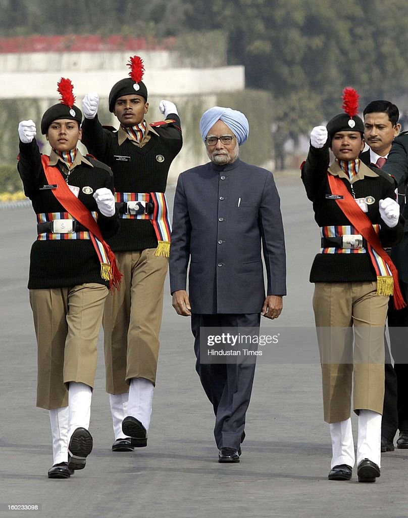 Prime Minister Manmohan Singh escorted by NCC cadets for Guard of Honour at NCC PM's rally at Delhi Cantt. Parade Ground on January 28, 2013 in New Delhi, India.