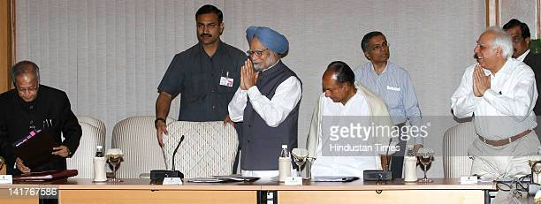 Prime Minister Manmohan Singh flanked by Finance Minister Pranab Mukherjee and Defence AK Antony with Union Minister for HRD Kapil Sibal gather...
