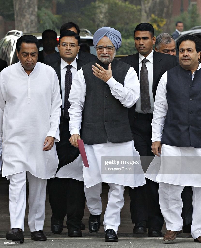 Prime Minister Manmohan Singh, flanked by Union Minister for Parliamentary Affairs Kamal Nath, and Ministers of State Rajiv Shukla, arrives to address the media at Parliament House on the first day of its winter session on November 22, 2012 in New Delhi, India. Parliament's winter session began on a stormy note as the issue of FDI in trade and reservation for ST/SC in promotion disrupted the Lok Sabha and Rajya Sabha.