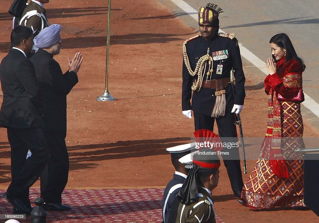 Prime Minister Manmohan Singh greeting Queen Jetsun Pema wife of chief guest King of Bhutan, Jigme Khesar Namgyel Wangchuck on his arrival during the 64th Republic Day parade celebration at Raj path on January 26, 2013 in New Delhi, India. India marked its Republic Day with celebrations held under heavy security, especially in New Delhi where large areas were sealed off for an annual parade of military hardware.