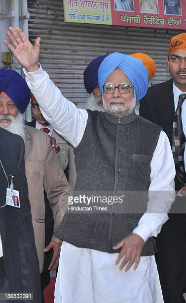 Prime Minister Manmohan Singh greeting to public during his visit of Harmandar Sahib on January 1 2012 in Amritsar India The Prime Minister and his...