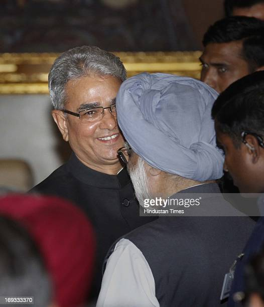 Prime Minister Manmohan Singh greets Shashi Kant Sharma after he took oath as Comptroller and Auditor General of India at a ceremony at Rashtrapati...