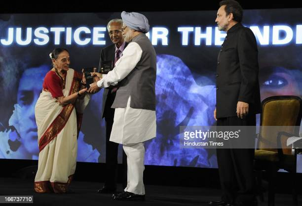 Prime Minister Manmohan Singh honours Justice J S Verma and Justice Leila Seth at NDTV Indian of the Year Award function on April 15 2013 in New...
