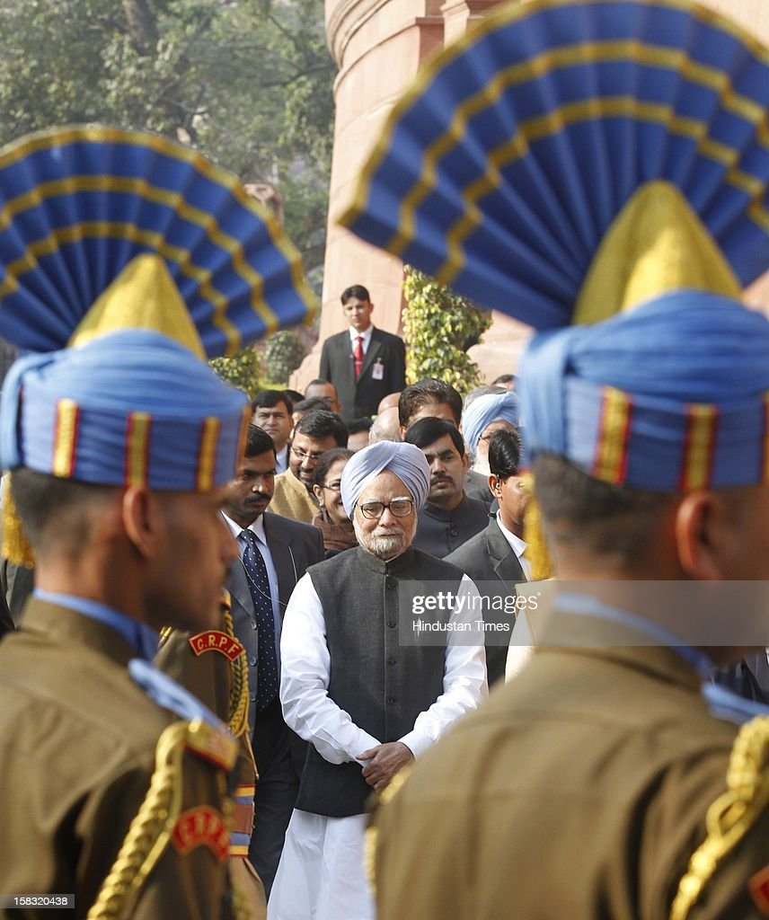 Prime Minister Manmohan Singh, pay homage to martyrs during a remembrance ceremony of the 2001 Parliament attack, at Parliament House on December 13, 2012 in New Delhi, India. Politicians gathered to observe the eleventh anniversary of a bloody militant attack on the complex, which left 14 dead on December 13, 2001.