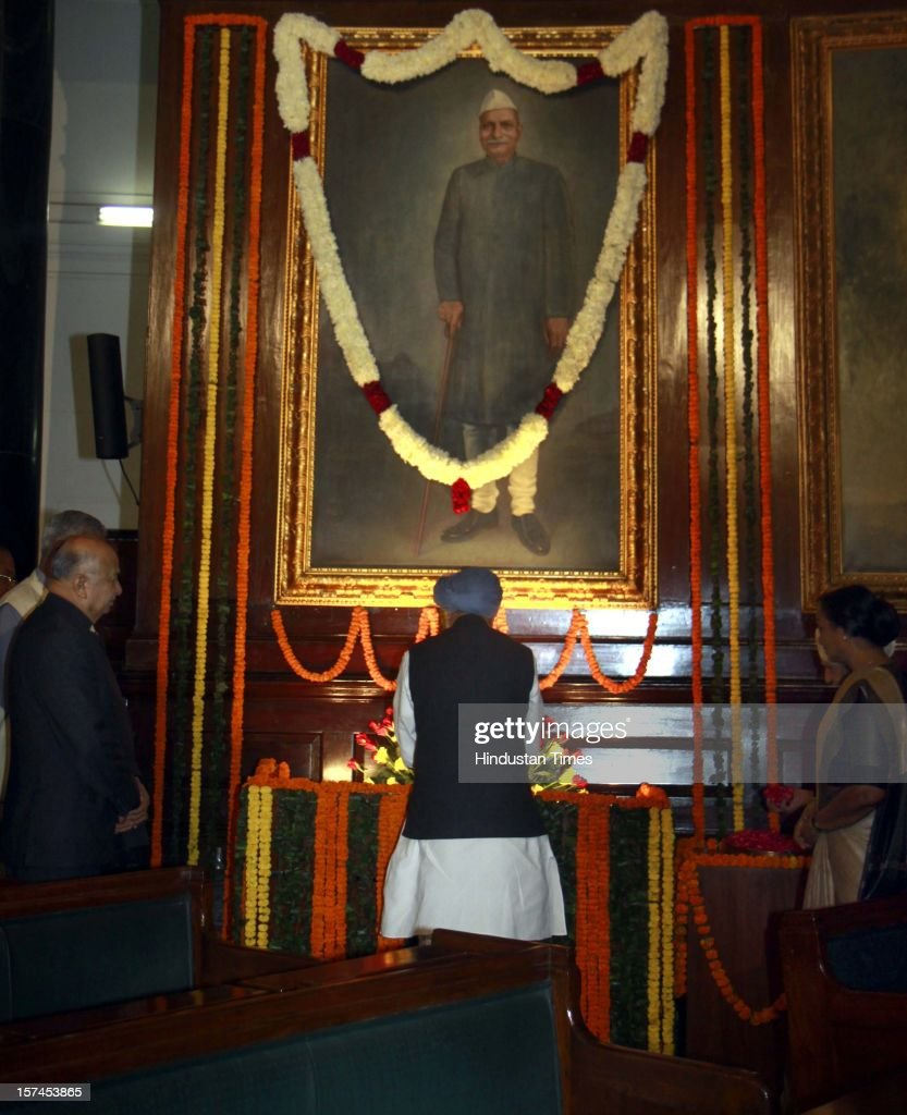 Prime Minister Manmohan Singh, paying floral tributes at the portrait of the First President of India, Late Dr. Rajendra Prasad on the occasion of his 128th birth anniversary, at Parliament House on December 3, 2012 in New Delhi, India.