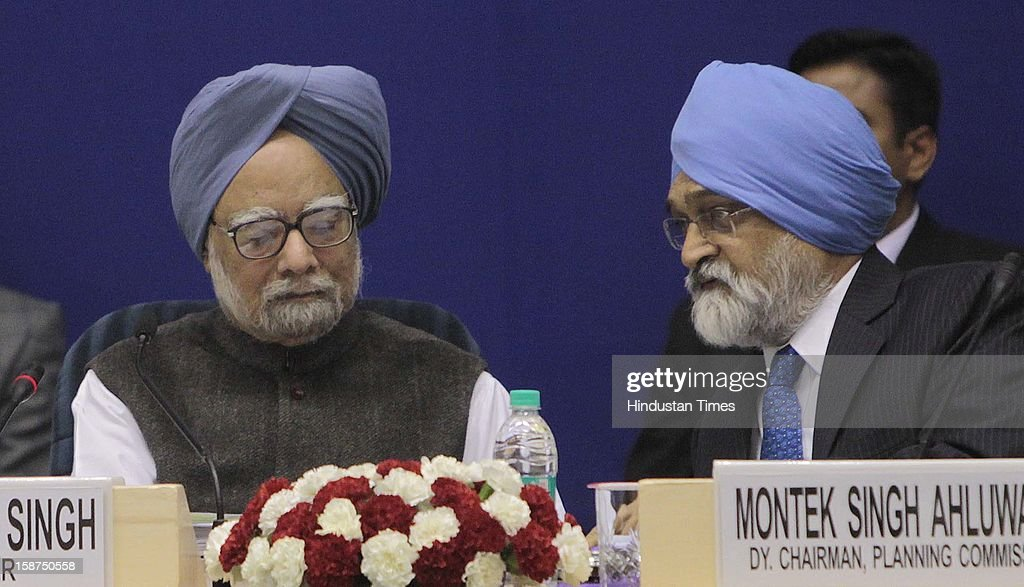 Prime Minister Manmohan Singh, Planning Commission Deputy Chairman Montek Singh Alhuwalia during the 57th National Development Council (NDC) meeting on December 27, 2012 in New Delhi, India.