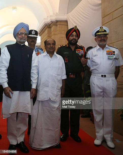Prime Minister Manmohan Singh poses for a photo with Defence Minister AK Antony Air Chief Marshal NAK Browne Army Chief Gen Bikram Singh and Navy...