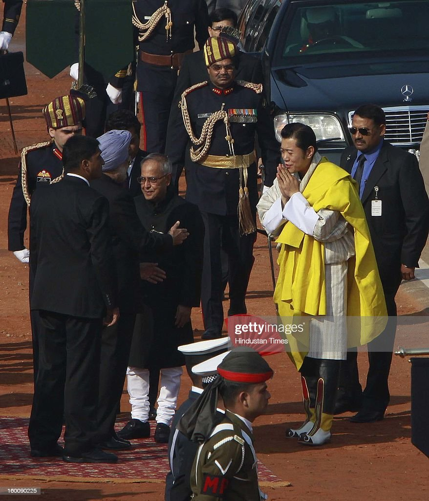 Prime Minister Manmohan Singh receives the chief guest King of Bhutan, Jigme Khesar Namgyel Wangchuck during the 64th Republic Day parade celebration at Raj path on January 26, 2013 in New Delhi, India. India marked its Republic Day with celebrations held under heavy security, especially in New Delhi where large areas were sealed off for an annual parade of military hardware.