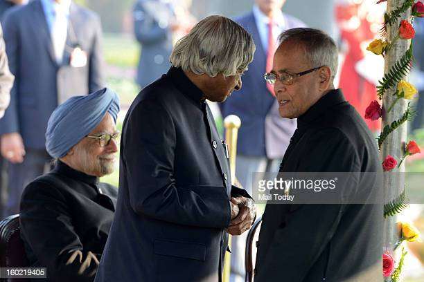 Prime Minister Manmohan Singh sitting and former President APJ Abdul Kalam and President Pranab Mukherjee during At Home reception hosted by the...