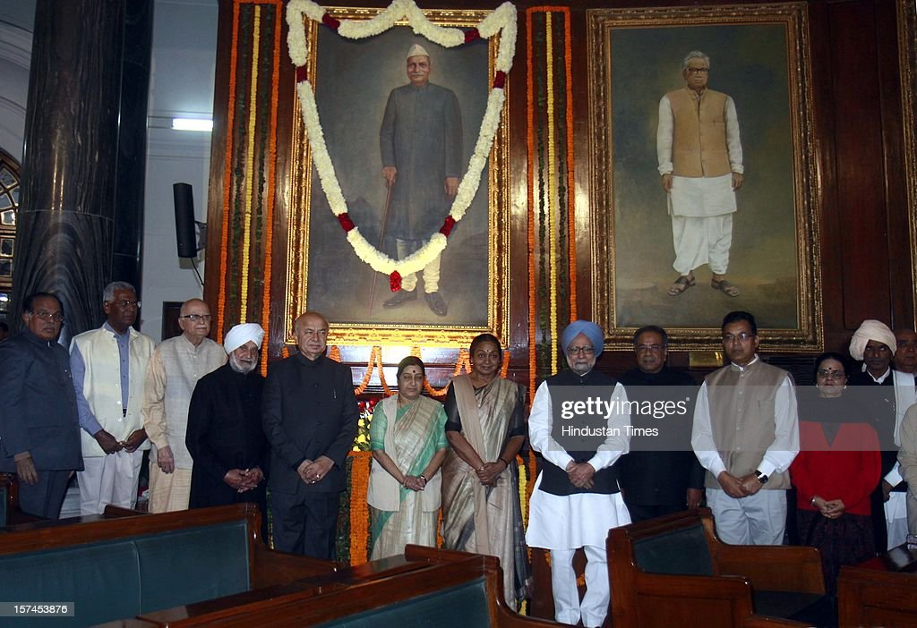 Prime Minister Manmohan Singh, Sushma Swaraj leader of opposition Lok Sabha, lok sabha speaker Meira Kumar, and other members of parliament after paying floral tributes at the portrait of the First President of India, Late Dr. Rajendra Prasad on the occasion of his 128th birth anniversary, at Parliament House on December 3, 2012 in New Delhi, India.