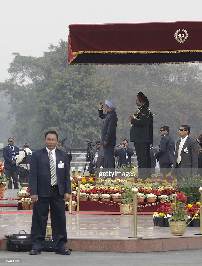 Prime Minister Manmohan Singh takes salutes at NCC PM's rally at Delhi Cantt. Parade Ground on January 28, 2013 in New Delhi, India.