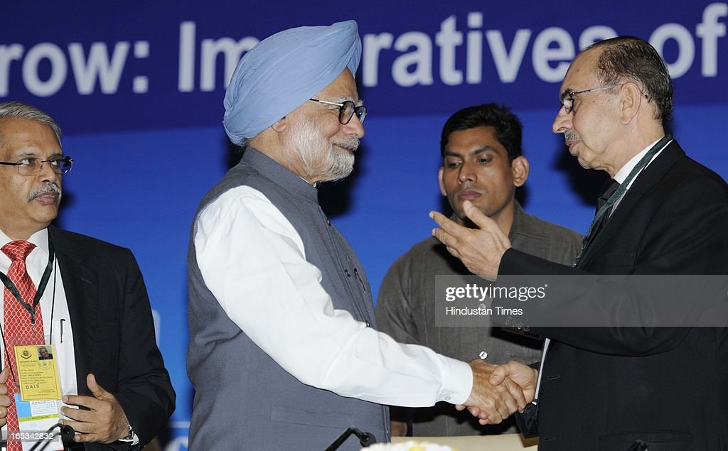 Prime Minister Manmohan Singh with CII President Adi Godrej and CII President-designate S Gopalakrishnan (L) during the CII Annual General Meeting and National Conference 2013 on April 3, 2013 in New Delhi, India. CII revealed that the theme has been designed keeping in mind the need for focusing on issues where industry can play a greater role in nation building and creating an enabling business environment,' said CII director general Chandrajit Banerjee.