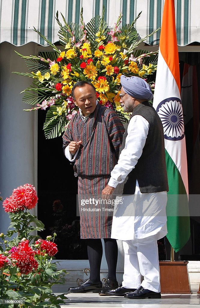 Prime Minister Manmohan Singh (R) with his Bhutanese counterpart Lyonchhen Jigmi Y Thinley at his residence on February 8, 2013 in New Delhi, India.