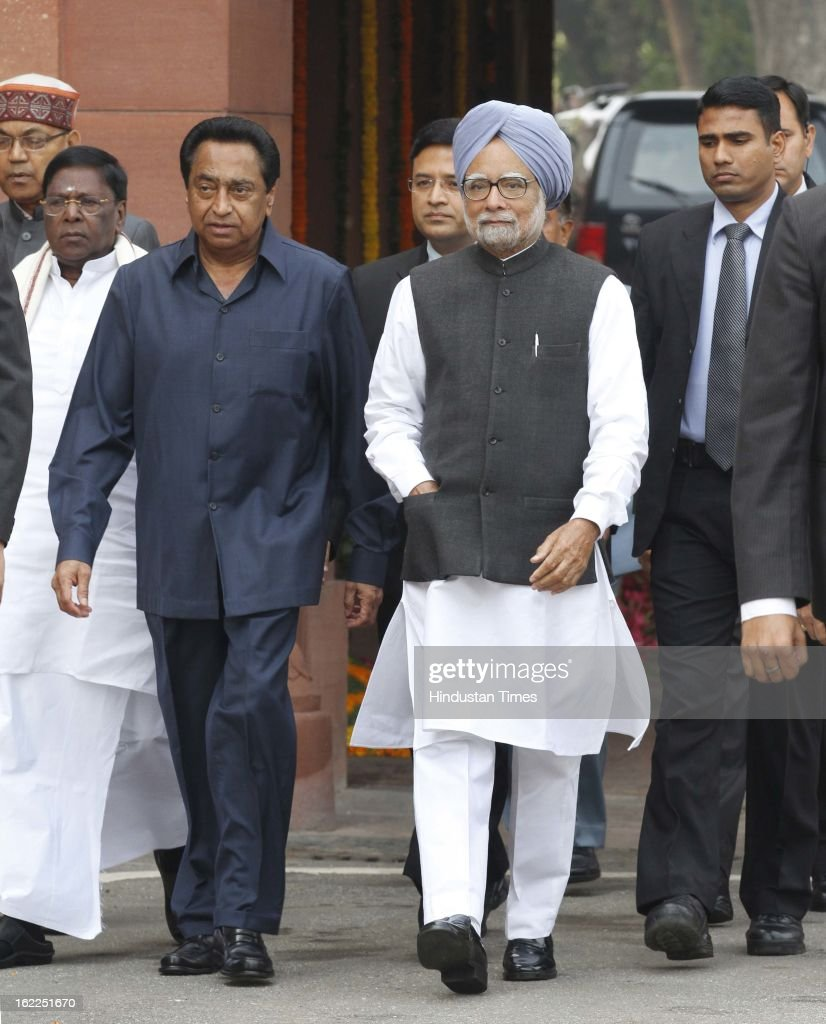 Prime Minister Manmohan Singh with his cabinet colleagues arrives at parliament on the first day of budget session on February 21, 2013 in New Delhi, India.