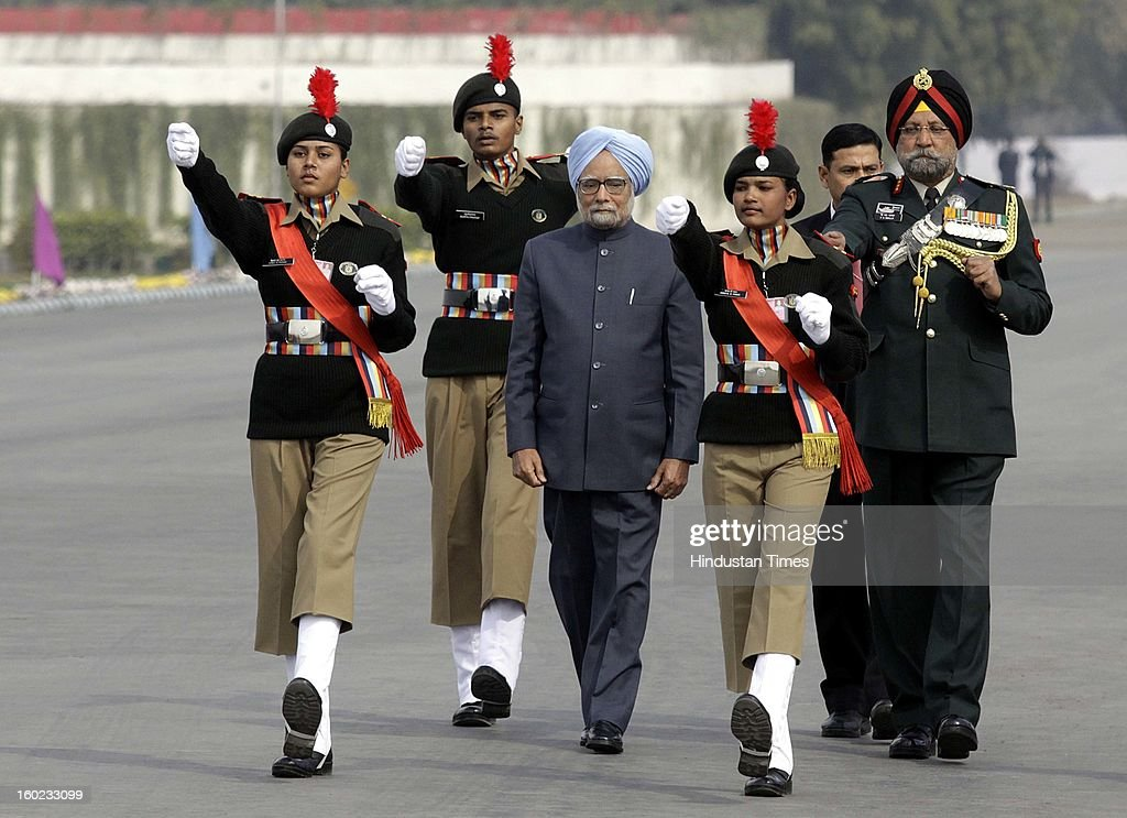 Prime Minister Manmohan Singh with NCC DG PS Bhalla ( R ) escorts him to Guard of Honour at NCC PM's rally at Delhi Cantt. Parade Ground on January 28, 2013 in New Delhi, India.