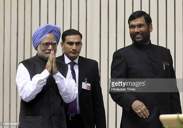 Prime Minister Manmohan Singh with Ram Vilas Paswan Chairman of Dalit and Minorities International Forum during conference on 'Problems and Issues of...
