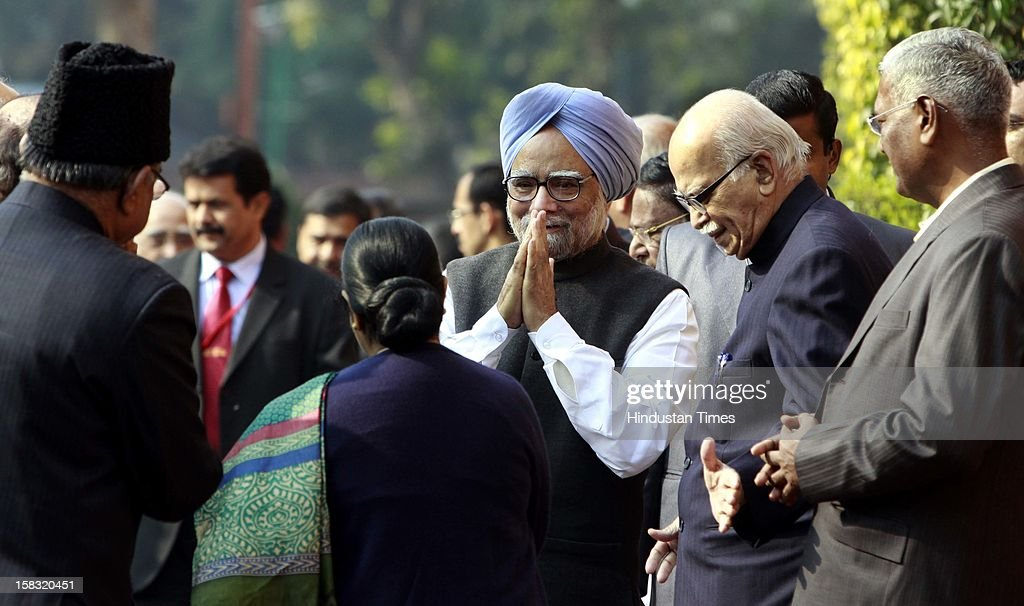 Prime Minister Manmohan Singh with senior BJP leader LK Advani and Sushma Swaraj before paying tributes to the martyrs of 2001 Parliament attack on its 11th anniversary, at Parliament House on December 13, 2012 in New Delhi, India.