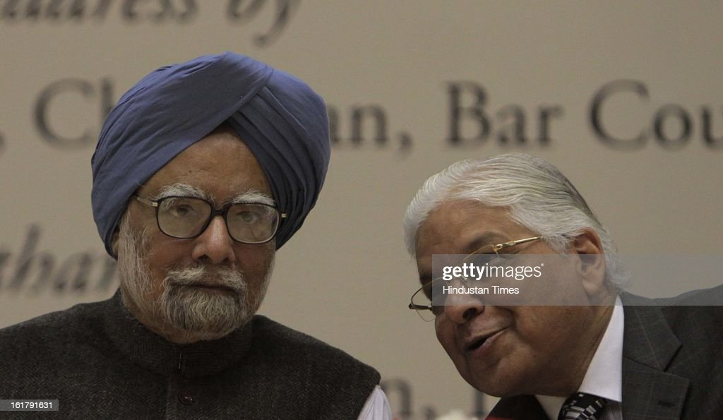 Prime Minister Manmohan Singh with Union Minister of Law Ashwani Kumar (R) during the Golden Jubilee Celebrations of the Bar Council of India on February 16, 2013 in New Delhi, India.