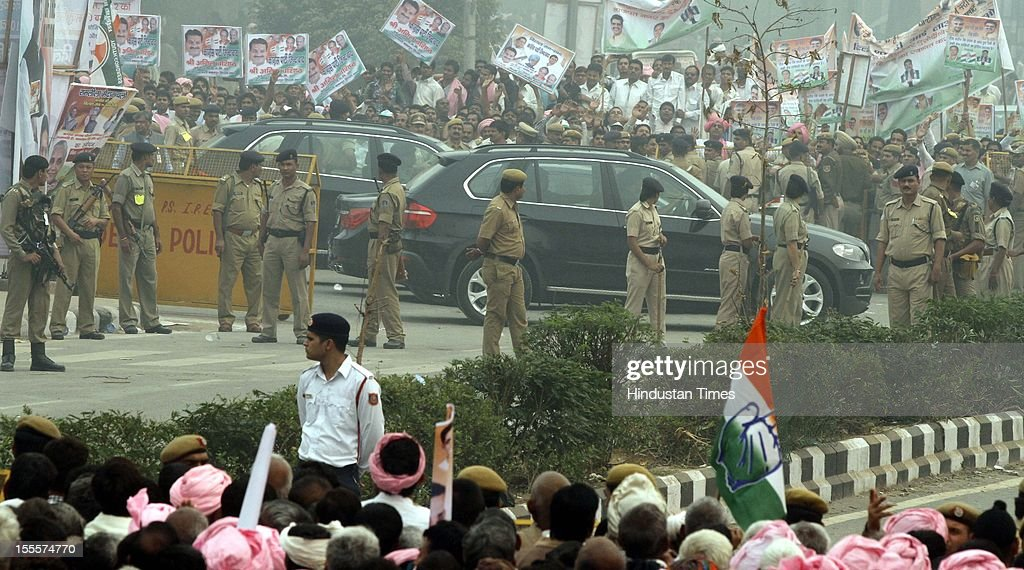 Prime Minister Manmohan Singh's convey passes through Party workers at Ramlila Maidan after the Congress Rally on November 04, 2012 in New Delhi, India. The rally is expected to set the agenda for the party's one-day brainstorming session at Surajkund on November 9 in which it plans to discuss the current political and economic situation.