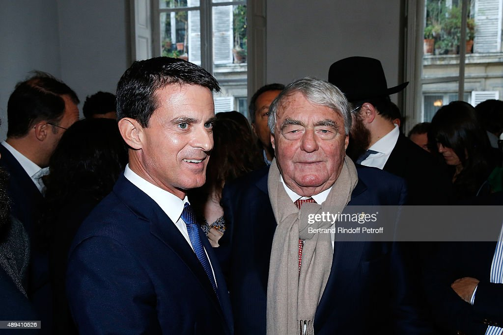 Prime Minister <a gi-track='captionPersonalityLinkClicked' href=/galleries/search?phrase=Manuel+Valls&family=editorial&specificpeople=2178864 ng-click='$event.stopPropagation()'>Manuel Valls</a> and <a gi-track='captionPersonalityLinkClicked' href=/galleries/search?phrase=Claude+Lanzmann&family=editorial&specificpeople=2464586 ng-click='$event.stopPropagation()'>Claude Lanzmann</a> attend the Marek Halter's Rosh Hashanah celebration for the 5776 Jewish New Year on September 20, 2015 in Paris, France.