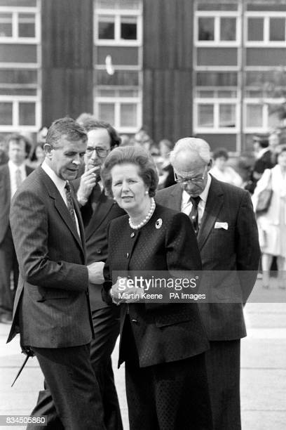 Prime Minister Margaret Thatcher and her husband Denis arriving to meet the members of the rescue services at Aberdeen Royal Infirmary today after...