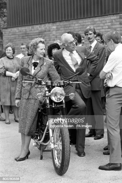 Prime Minister Margaret Thatcher and husband Denis take a look at a new Britishmade Matchless Matchless G80 single motorcycle at the LF Harris Plant...