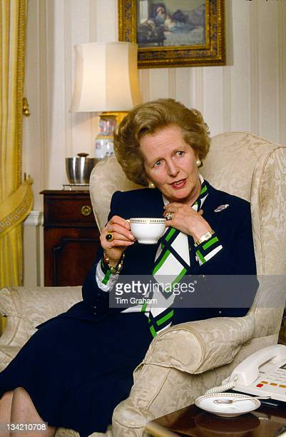 Prime Minister Margaret Thatcher drinks tea in the drawing room of her official residence at 10 Downing Street 1987 in London England