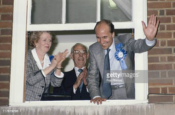 Prime Minister Margaret Thatcher her husband Denis Thatcher and Conservative Party chairman Norman Tebbit celebrate winning a third term in...