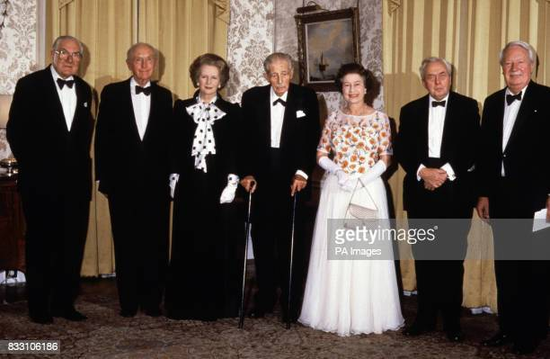 Prime Minister Margaret Thatcher is joined by Queen Elizabeth II and five former PMs at 10 Downing Street London as she hosts a dinner celebrating...