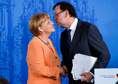 Prime Minister Mariano Rajoy kisses German Chancellor Angela Merkel at the end of a press conference as part of a two days summit on August 25 2014...