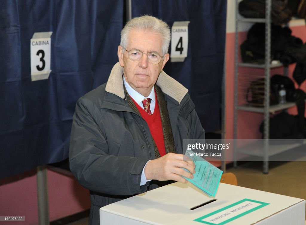 Prime Minister <a gi-track='captionPersonalityLinkClicked' href=/galleries/search?phrase=Mario+Monti&family=editorial&specificpeople=632091 ng-click='$event.stopPropagation()'>Mario Monti</a> casts his vote in a polling station on February 24, 2013 in Milan, Italy. Italians are heading to the polls today to vote in the elections, as the country remains in the grip of economic problems . Pier Luigi Bersani's centre-left alliance is believed to be a few points ahead of the centre-right bloc led by ex-Prime Minister Silvio Berlusconi.