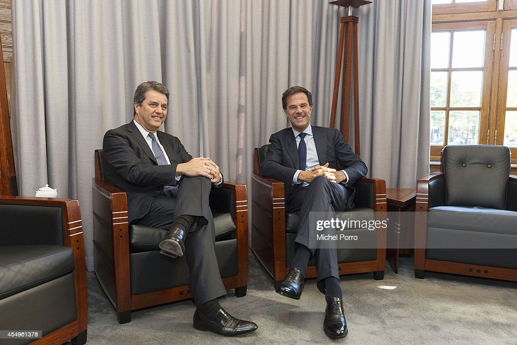 Prime Minister <a gi-track='captionPersonalityLinkClicked' href=/galleries/search?phrase=Mark+Rutte&family=editorial&specificpeople=4509362 ng-click='$event.stopPropagation()'>Mark Rutte</a> (R) meets Director General of the World Trade Organisation (WTO) Roberto Azevedo on September 8, 2014 in The Hague The Netherlands. Azevedo is here on a one-day visit to strengthen ties between The Netherlands and the WTO.