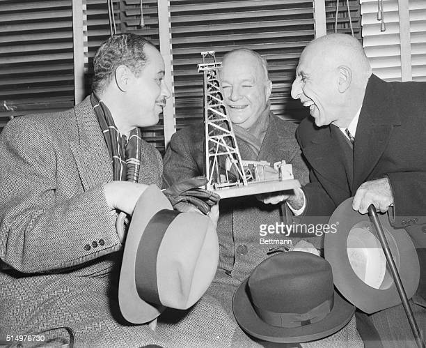 Prime Minister Mossadegh of Iran was greatly amused by a miniature oil well which was presented to him by a Washington attorney Former ambassador to...