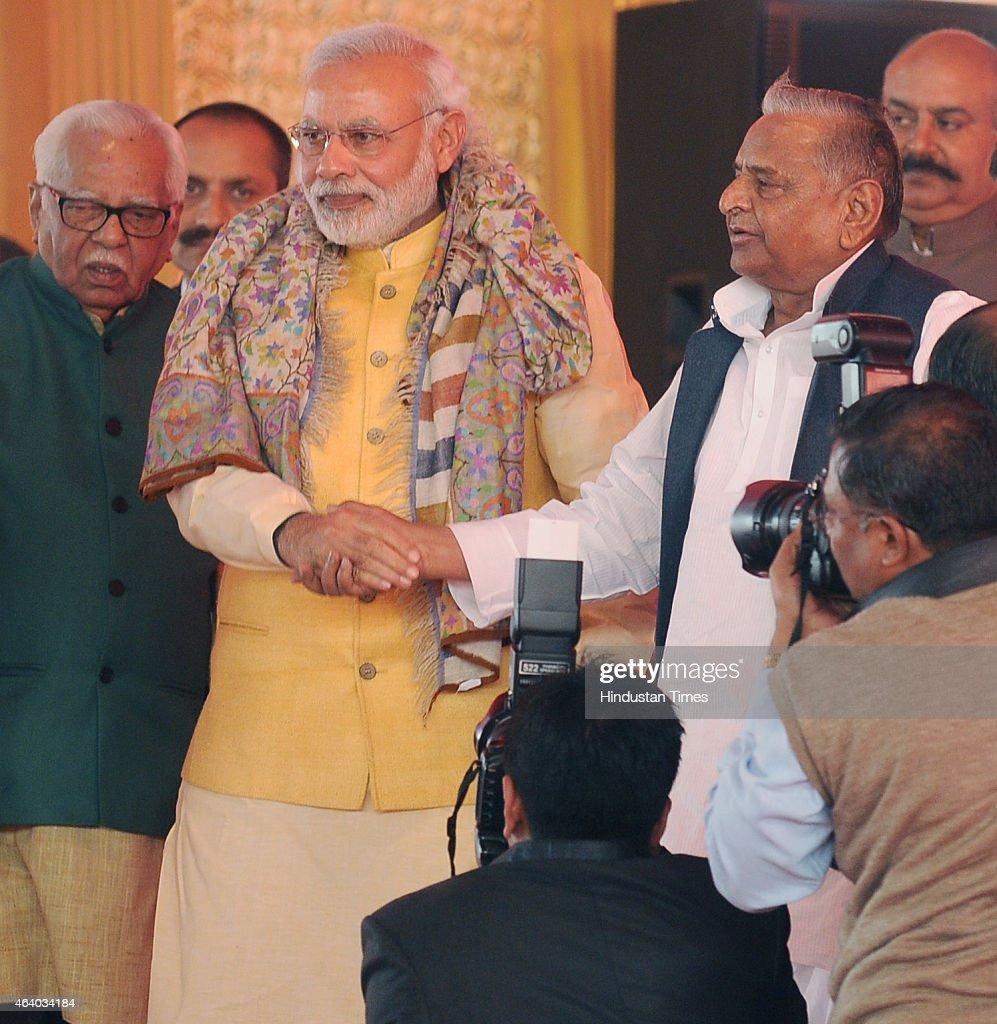 Prime Minister Narendera Modi leads the way holding SP national president Mulayam Singh Yadav hand during the prewedding ceremony of Samajwadi Party...