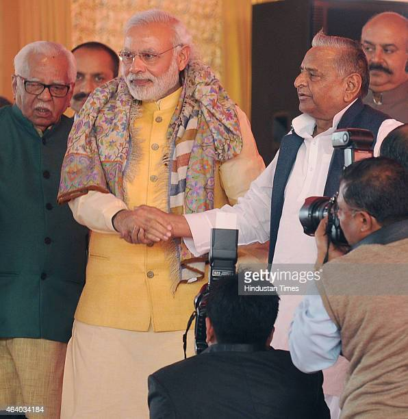 Prime Minister Narendera Modi leads the way holding SP national president Mulayam Singh Yadav hand during the prewedding ceremony of Samajwadi Party...